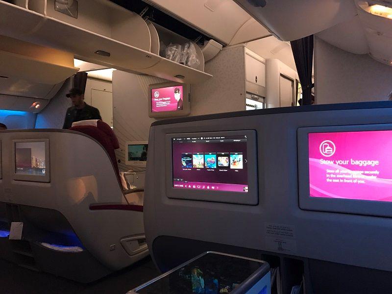 como é voar pela classe executiva da qatar airways